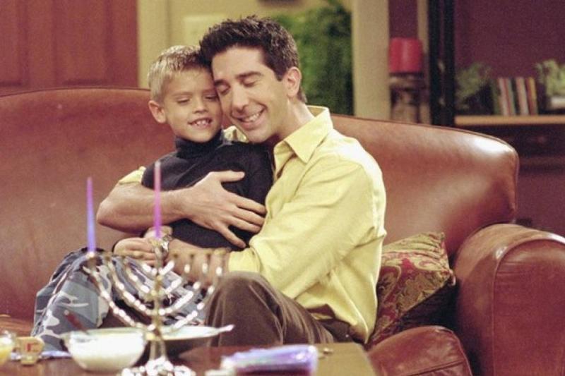 ross hugging his son