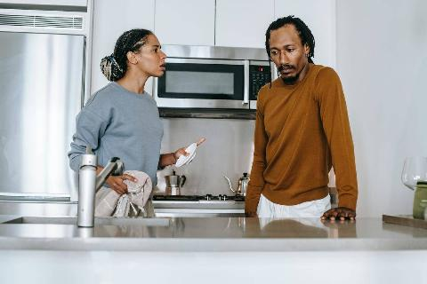 man and woman arguing in kitchen