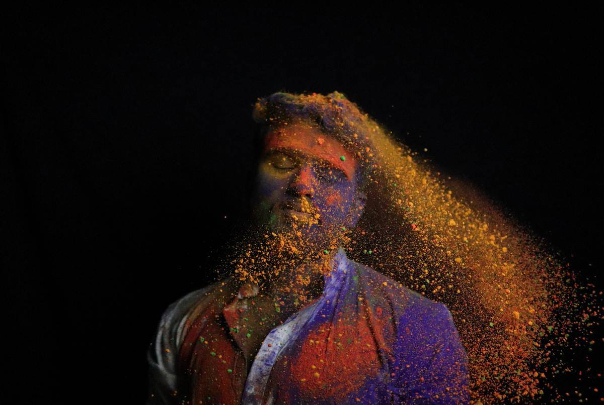 man with paint colors splattering