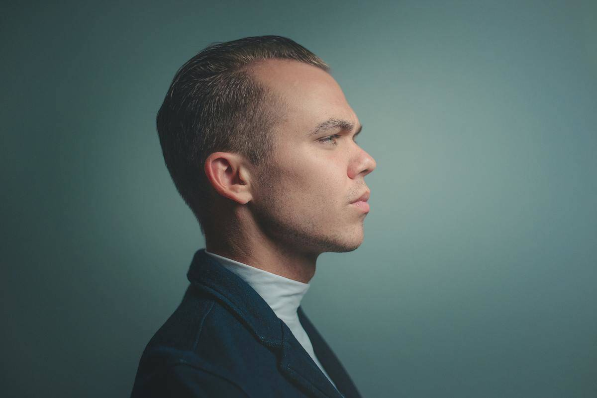man's profile shows serious face