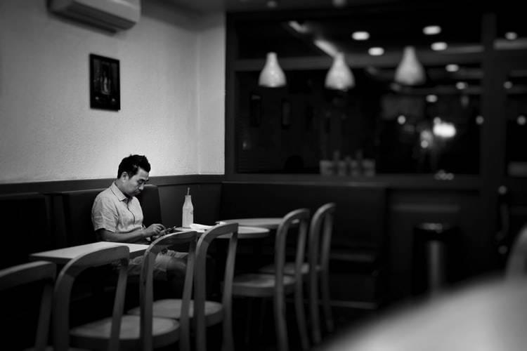 man sitting alone at a restaurant