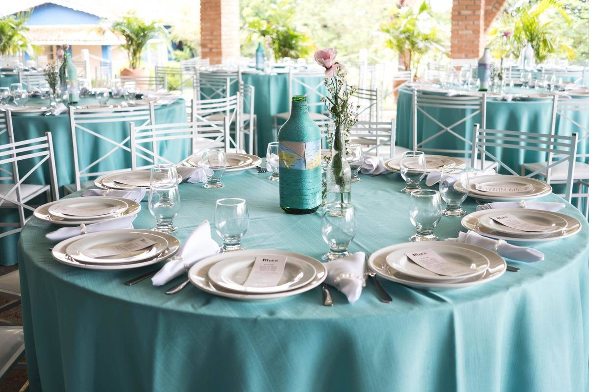 wedding table arrangement with blue tablecloth