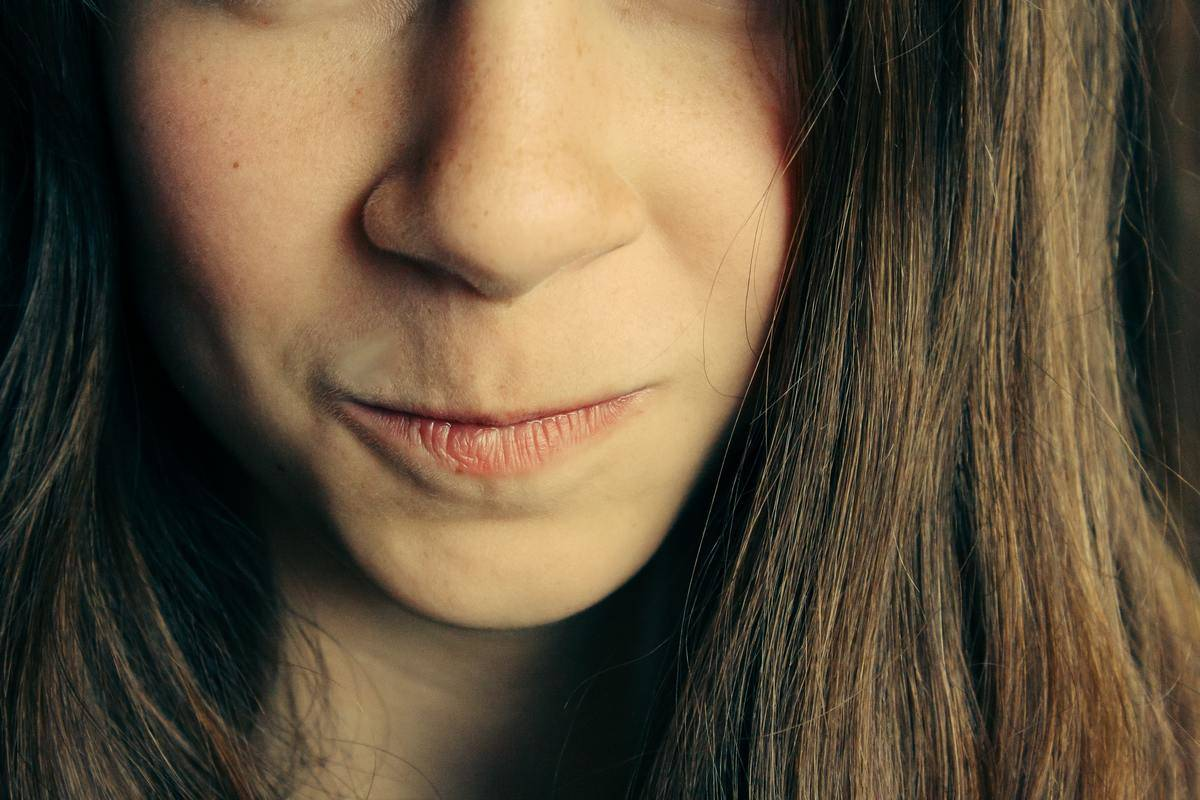 woman looks angry closeup