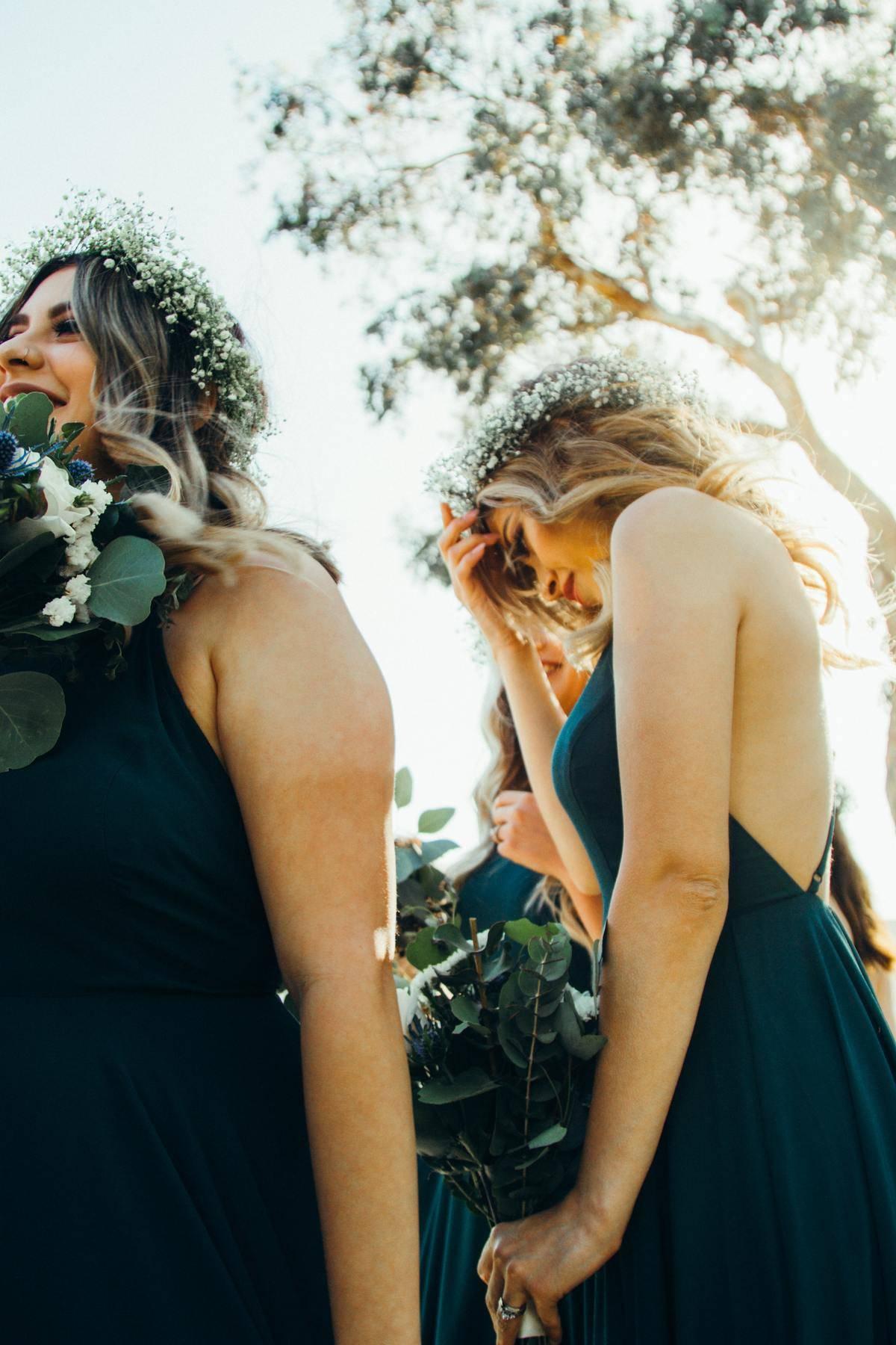 bridesmaid wearing floral crown looking down