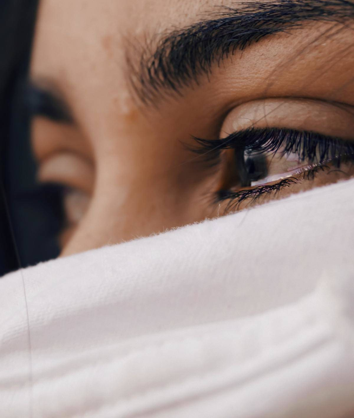 close-up shot of woman with tear in her eye