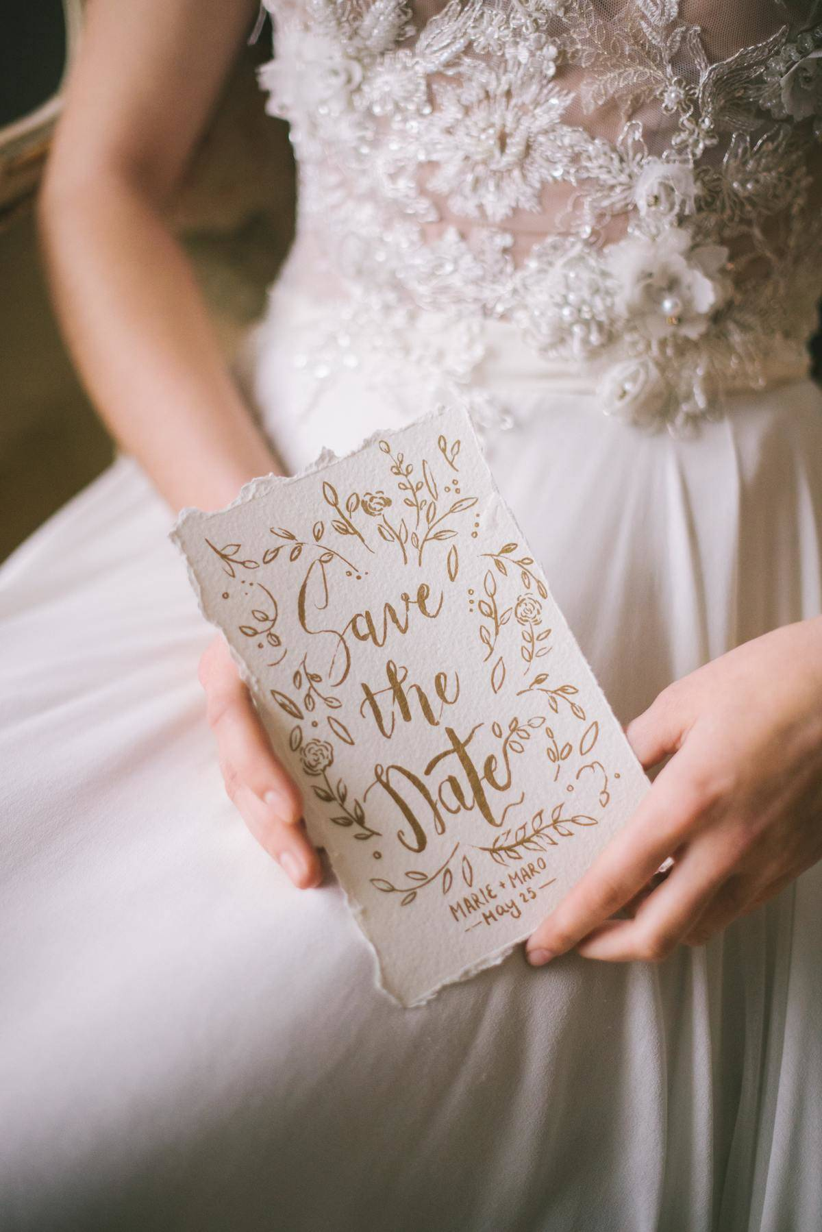 Bride holding a save the date card