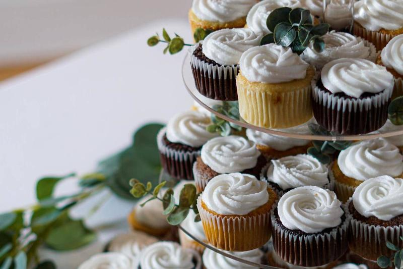 Tower of cupcakes at a wedding dessert table