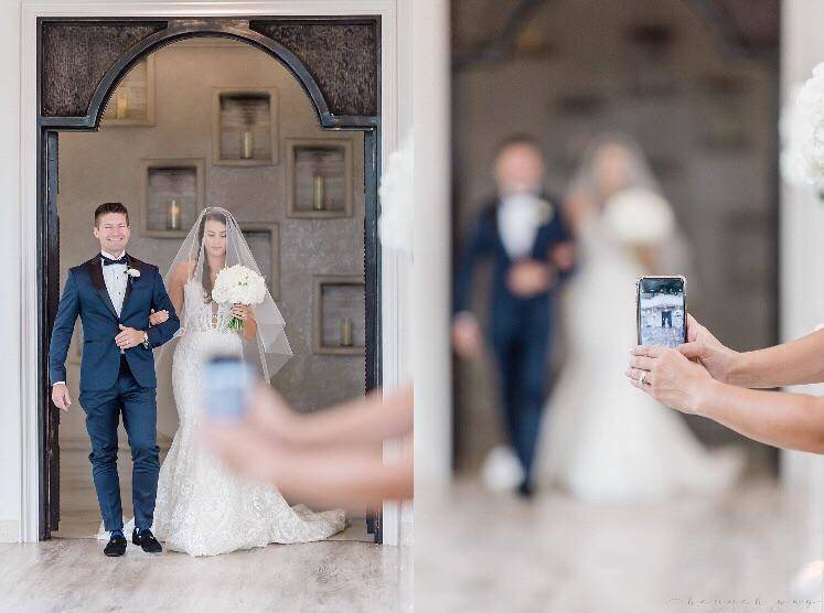 Ruined wedding photo of a guest's phone blocking the photographer