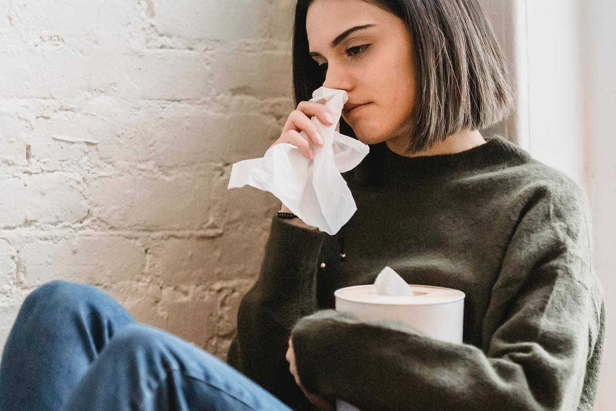 Woman holding tissue and crying