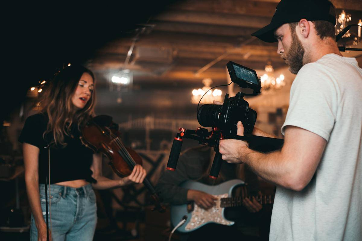 camera filming violinist