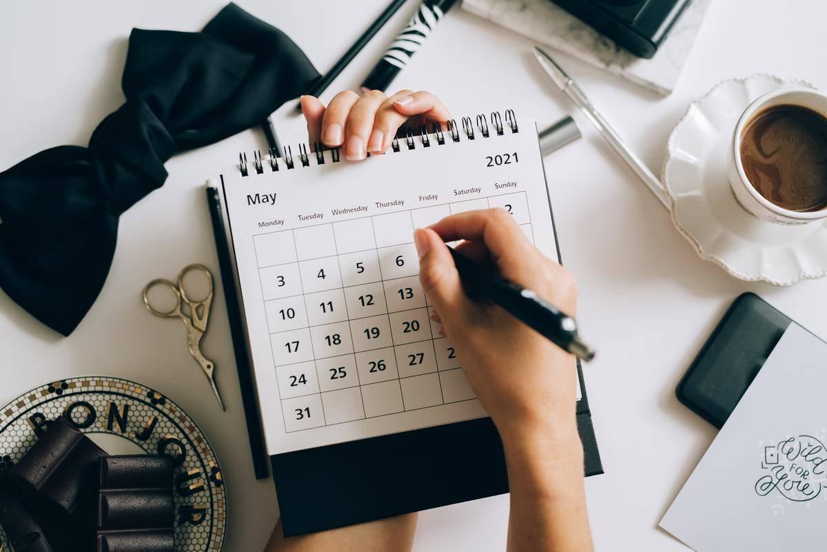 checking off calendar with pen
