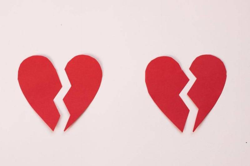 two paper cutout broken hearts