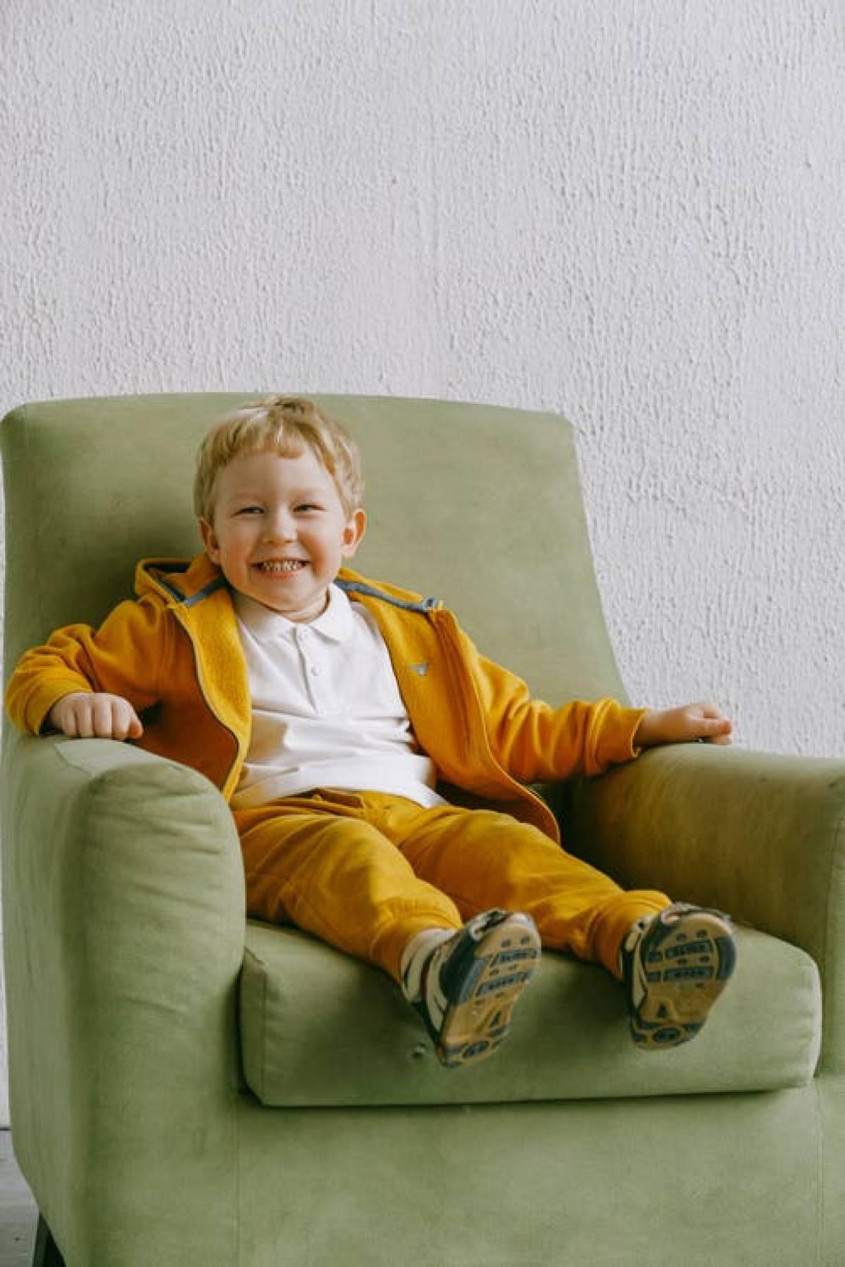 kid on large armchair