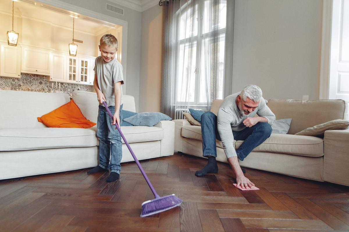 man and boy cleaning the floor