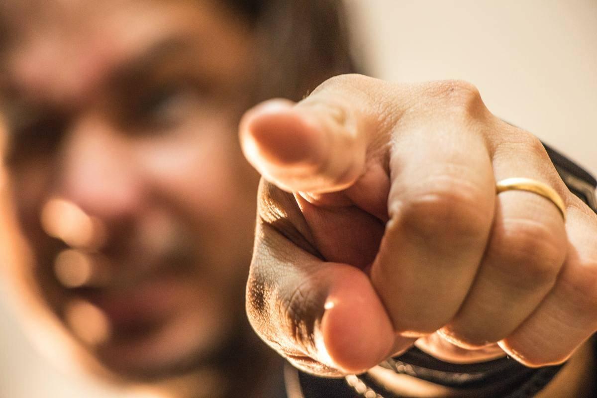 Man pointing index finger at camera