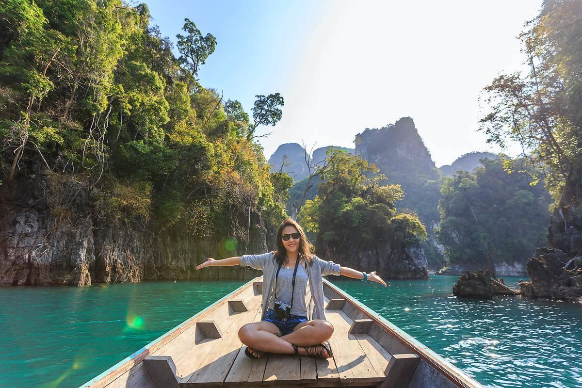 woman in canoe in lagoon