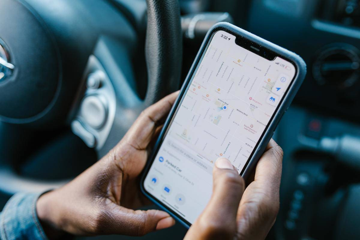 A person uses the GPS app on their cell phone