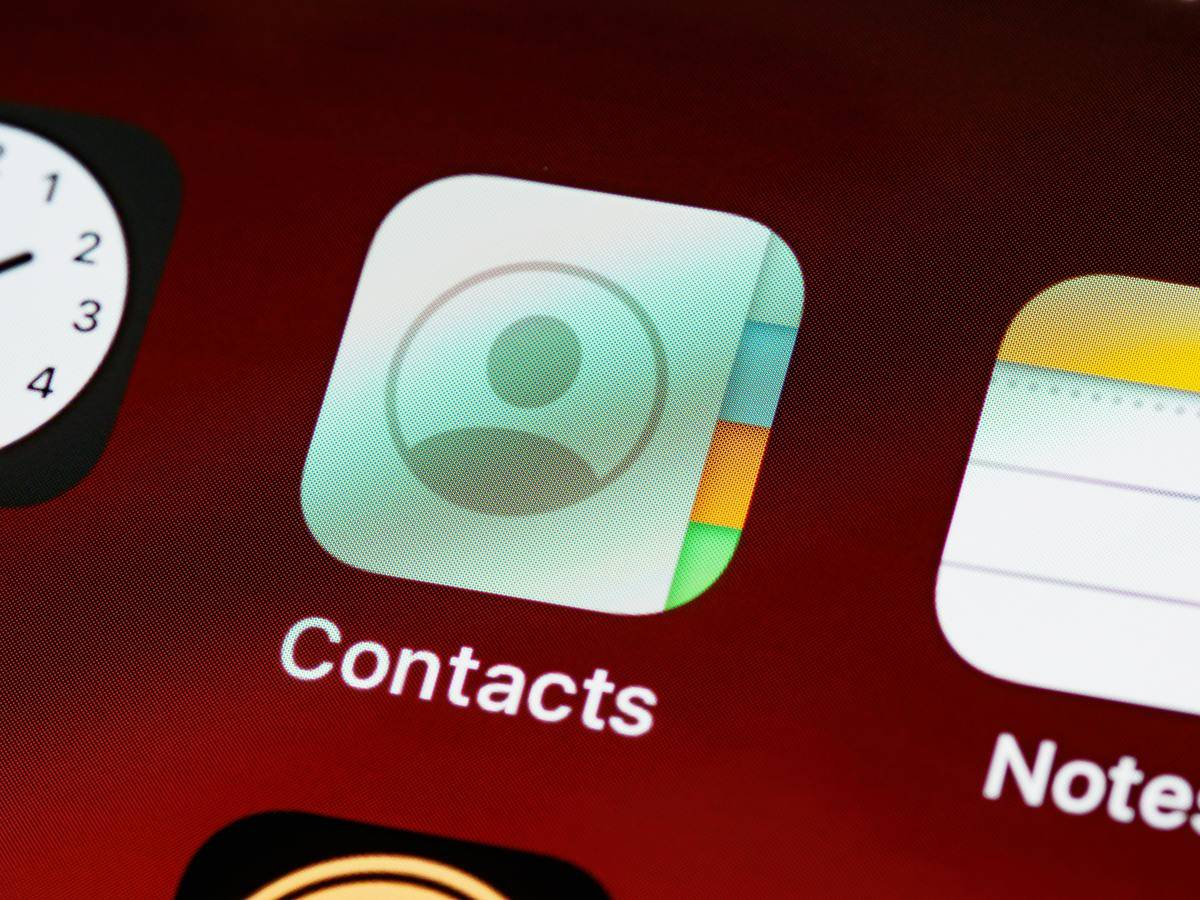 The contacts app on a person's cell phone