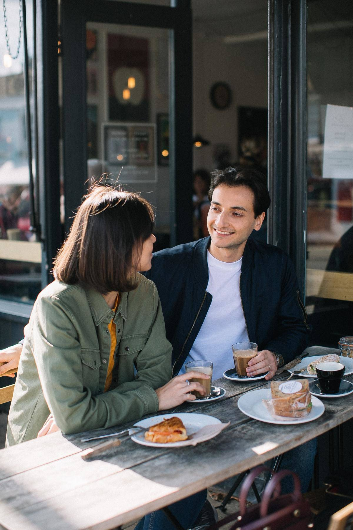 Couple at table talking over coffee