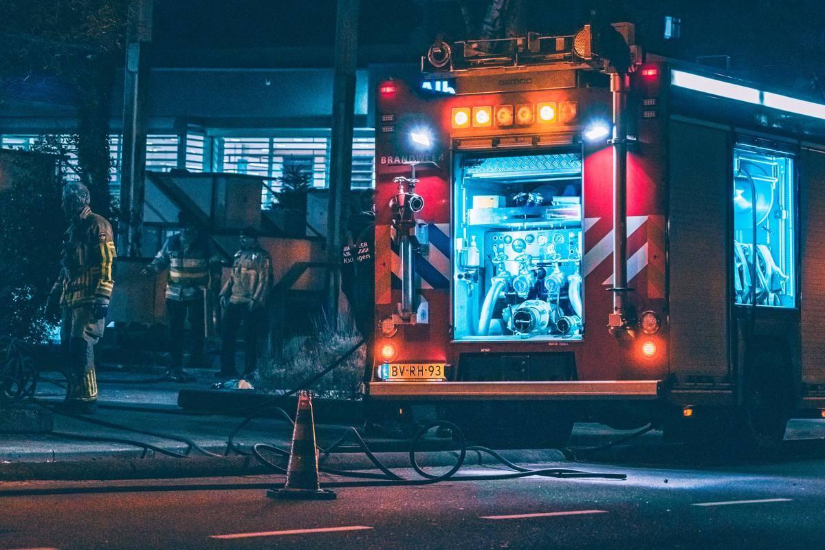 Fire truck on the roadside in the dark