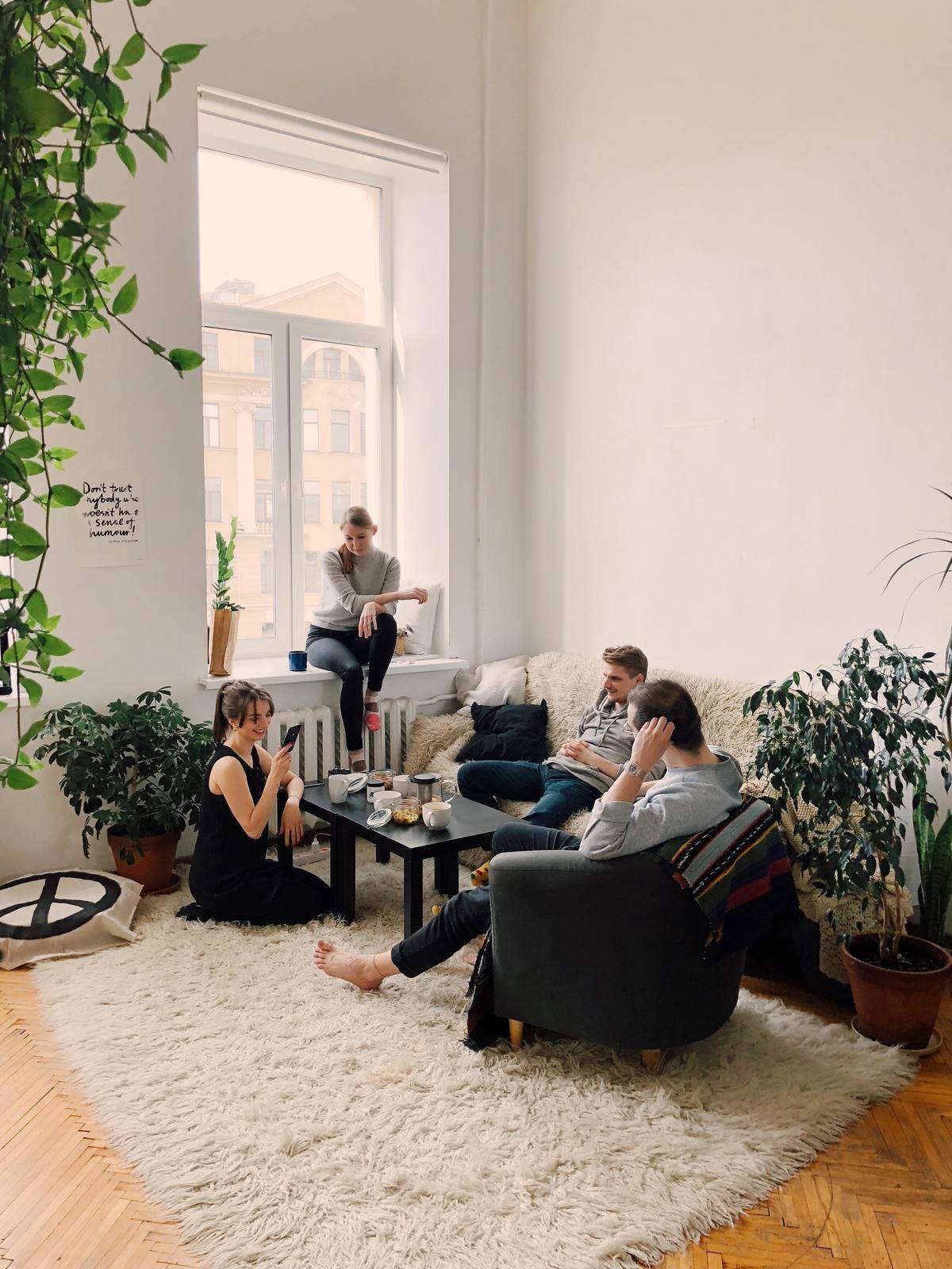 Friends group socializing in living room