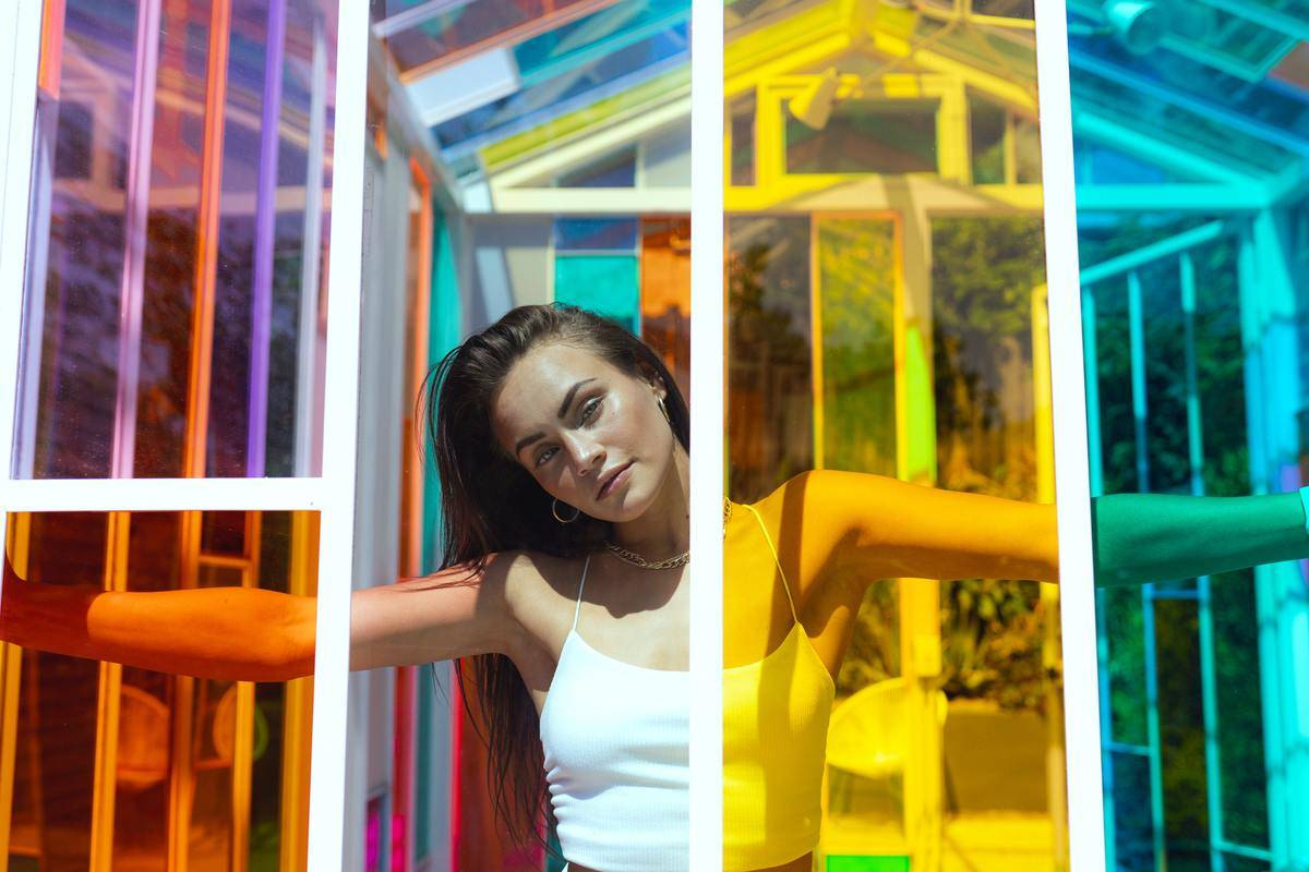 Girl in colorful greenhouse shed