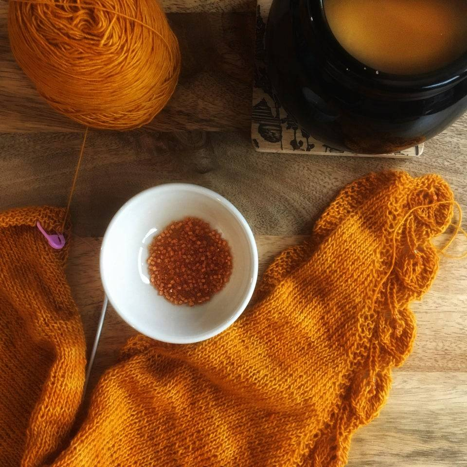 orange scarf being knitted