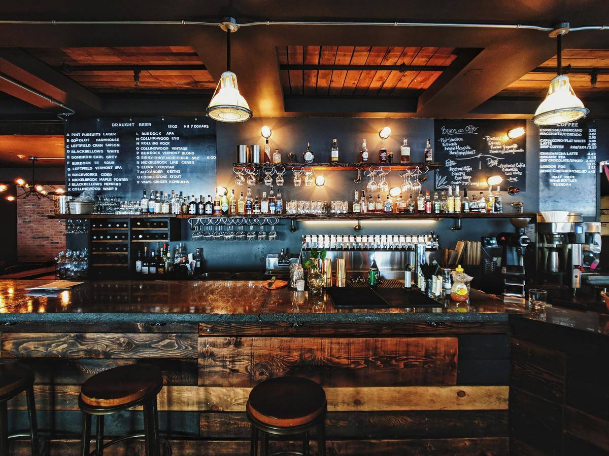 Wooden bar with stools and hanging lighting