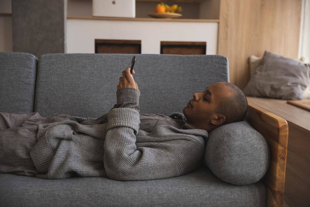 Man on cell phone on couch