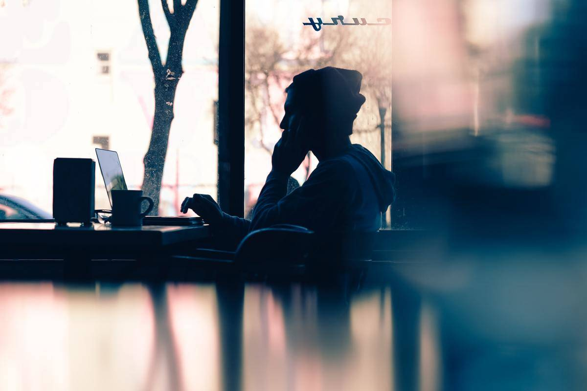 Man sits alone on laptop