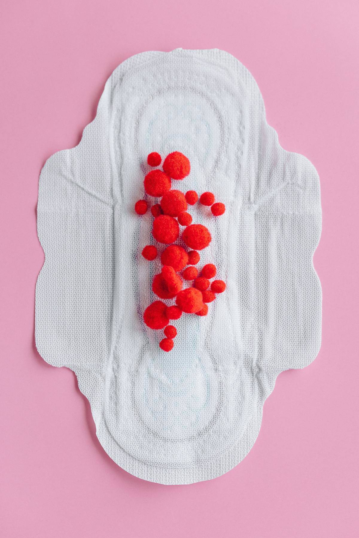Period pad with red balls on it meant to simulate blood