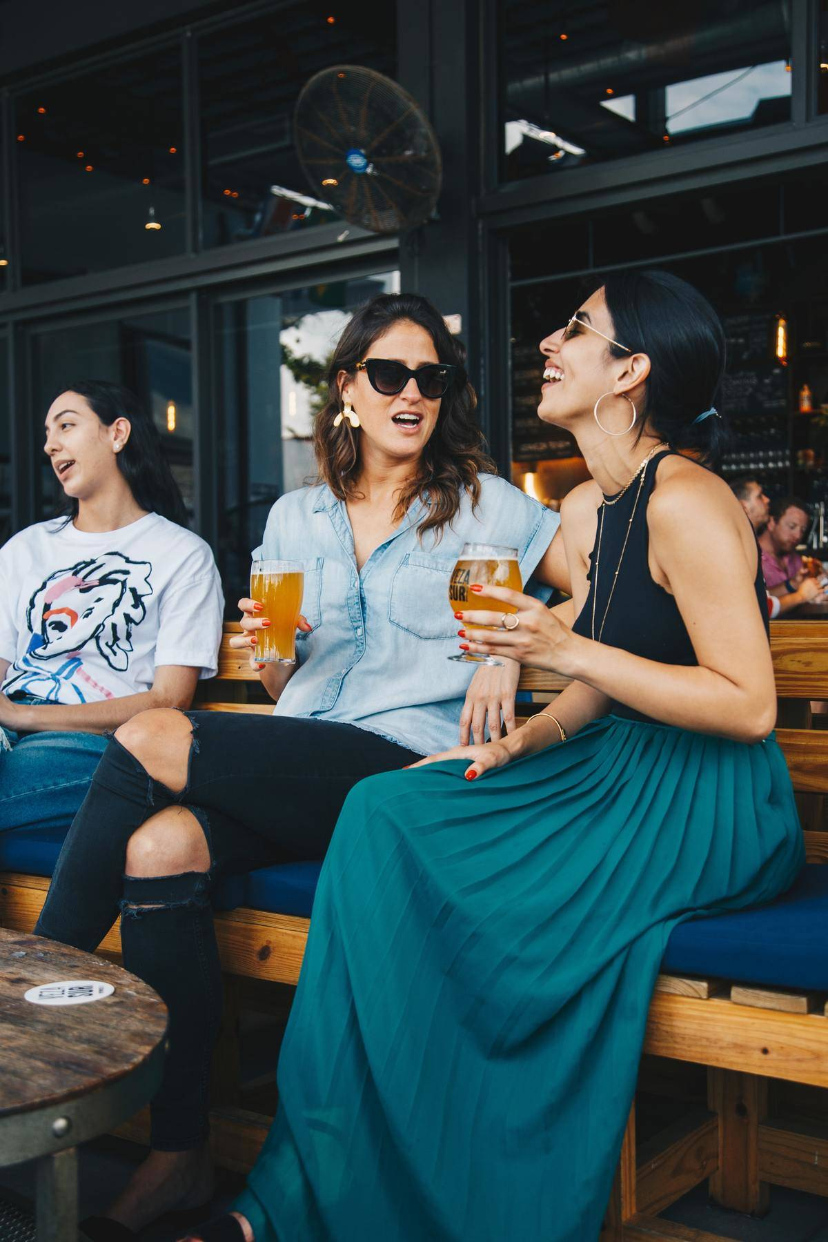 People laughing and talking on restaurant patio