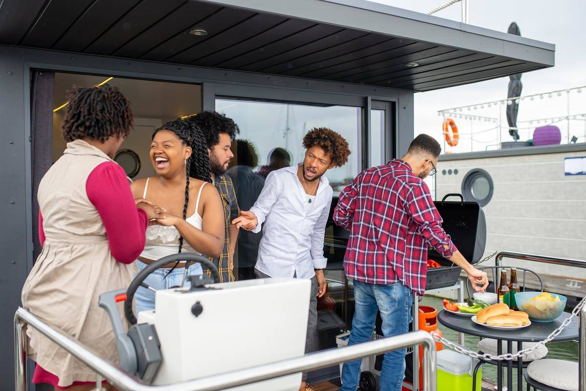 People in group at party near barbecue on patio