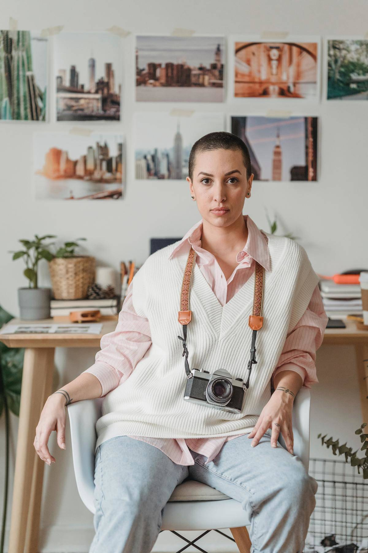Woman sits alone with a camera around her neck