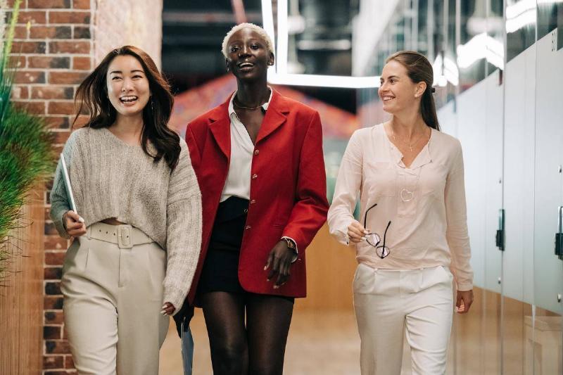 Women walking and smiling