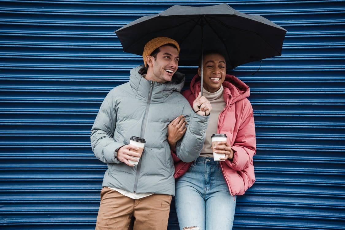 couple laughing under umbrella
