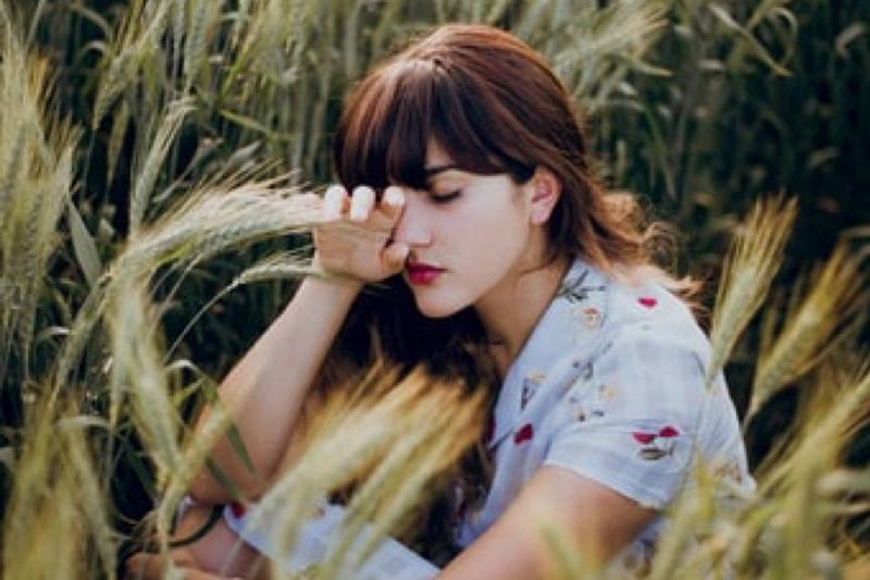 woman crying in field