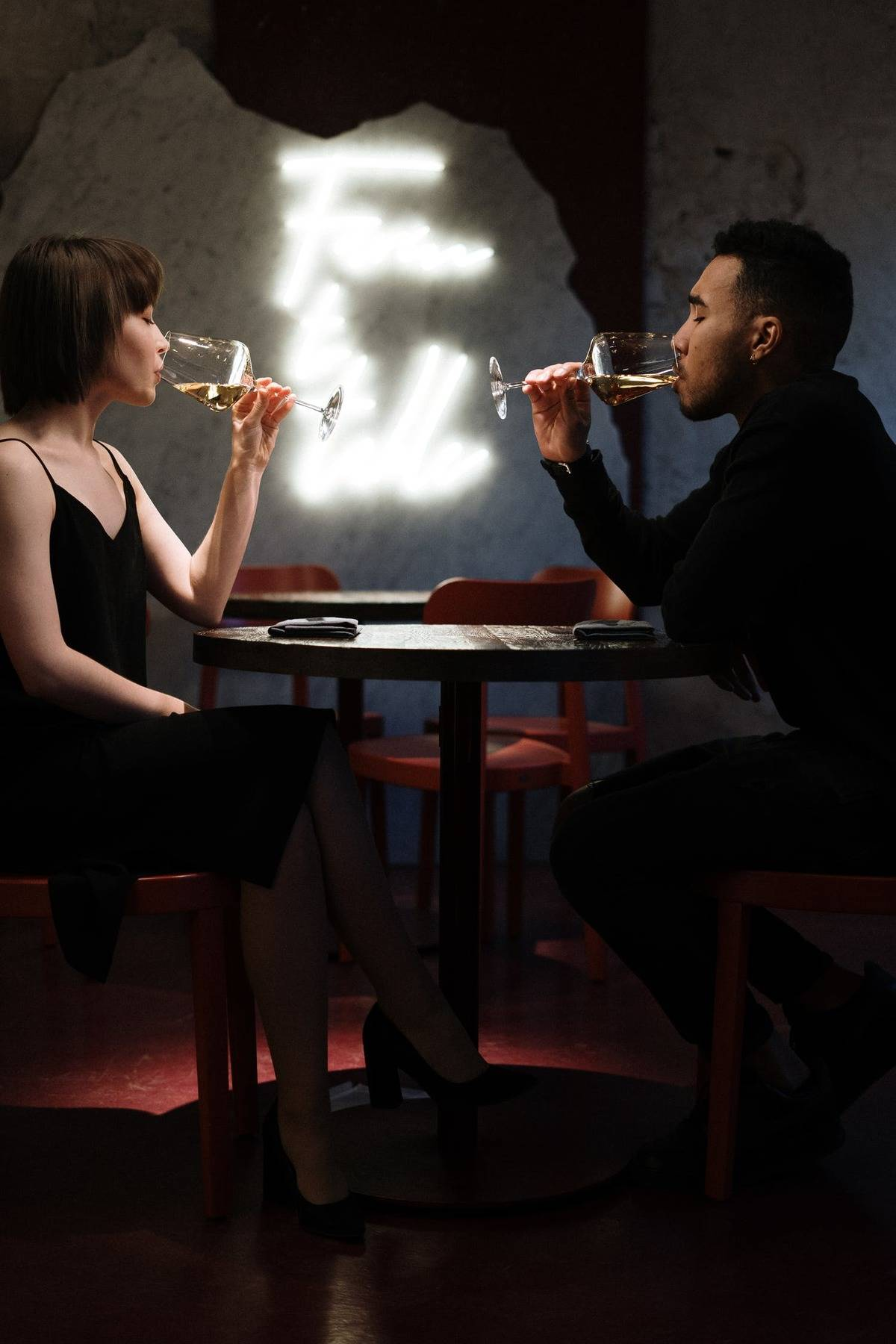 man and woman on date at restaurant