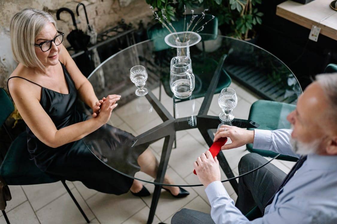 two people sitting at a patio table