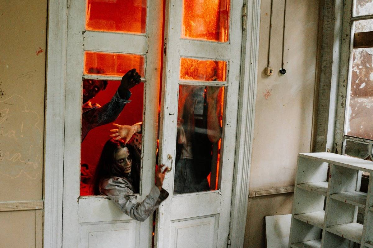 zombies trying to get into house