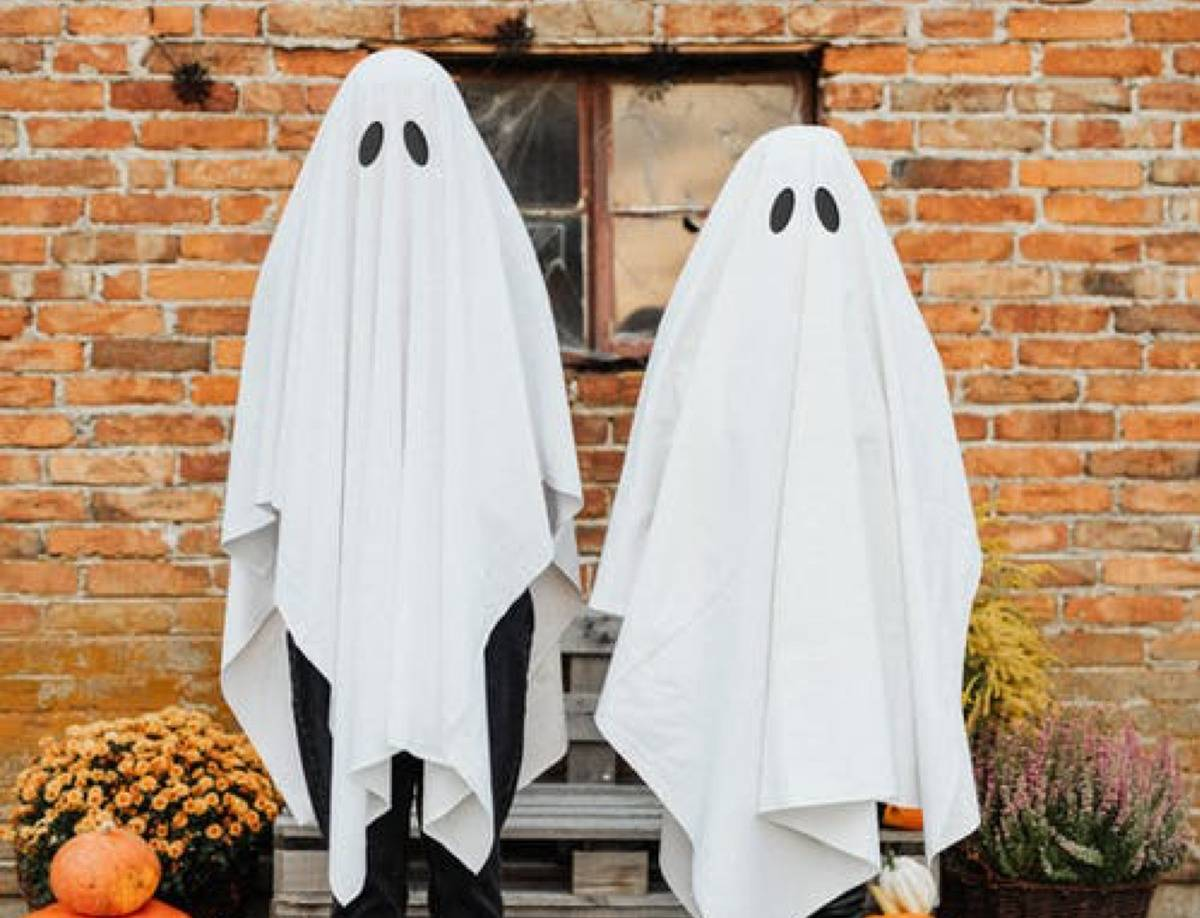 two people dressed as ghosts