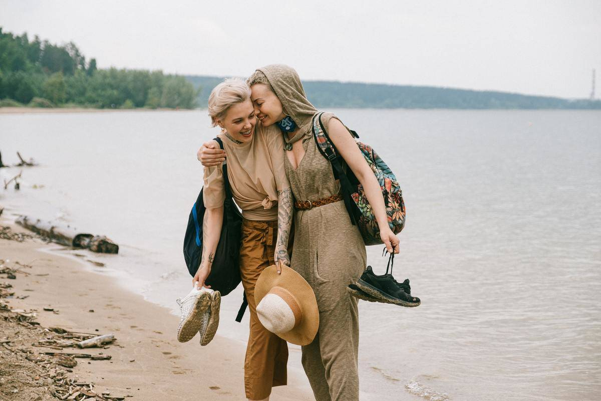 Women on beach laughing