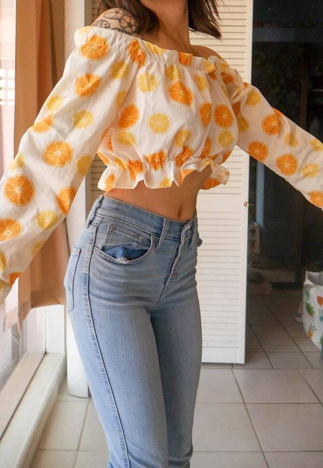 A hand-sewn white, orange and yellow woman's crop top.
