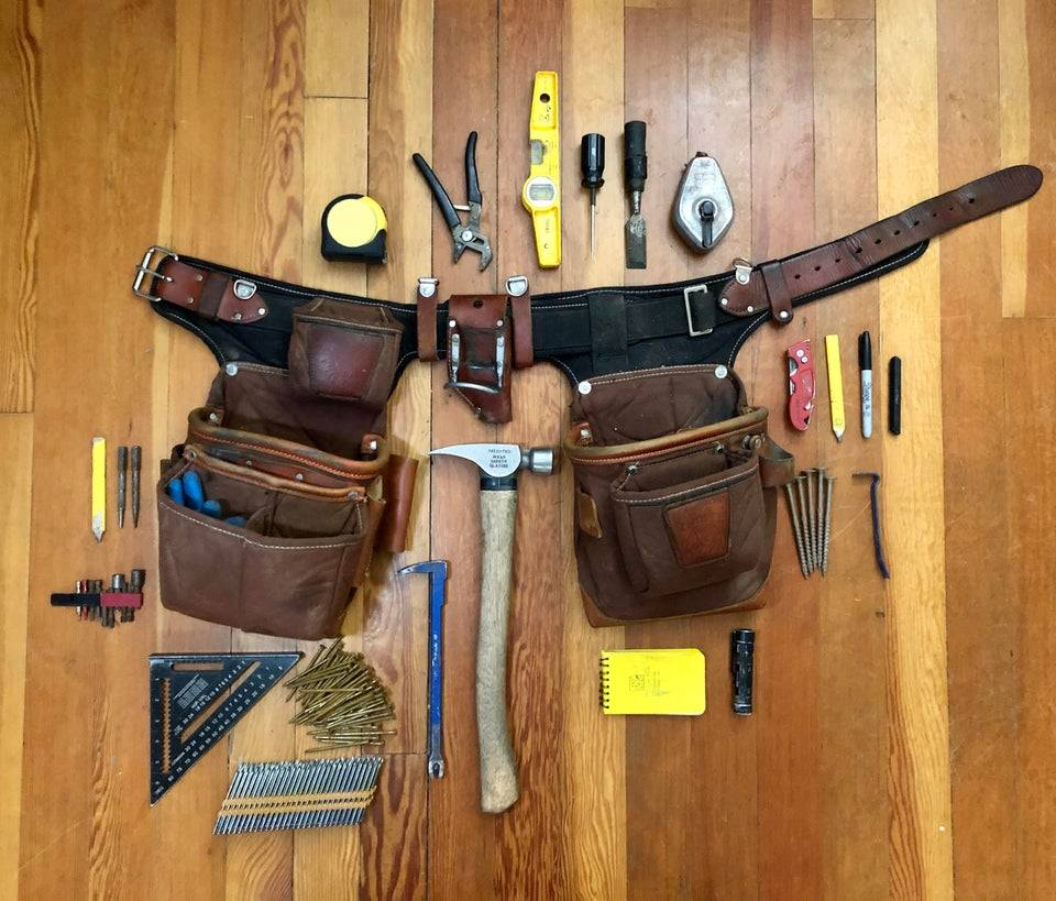 Handyman's belt laid out on the floor with all the tools