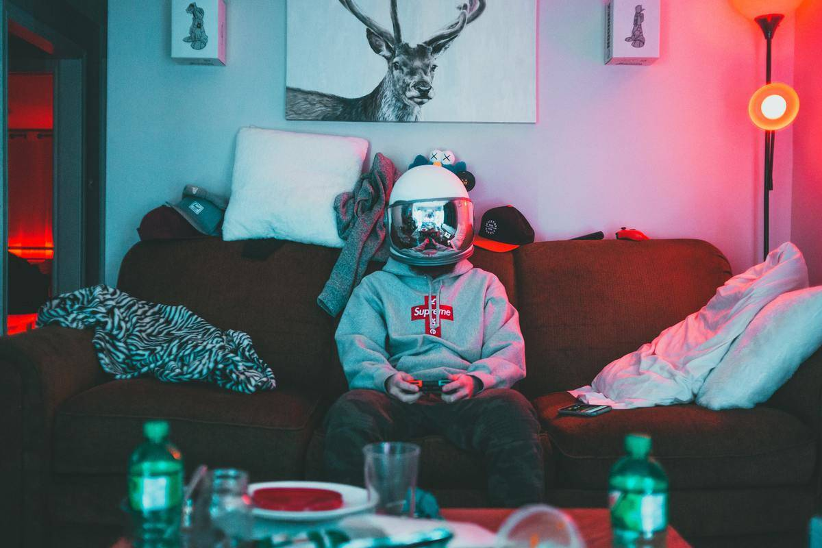 Man wearing helmet is gaming