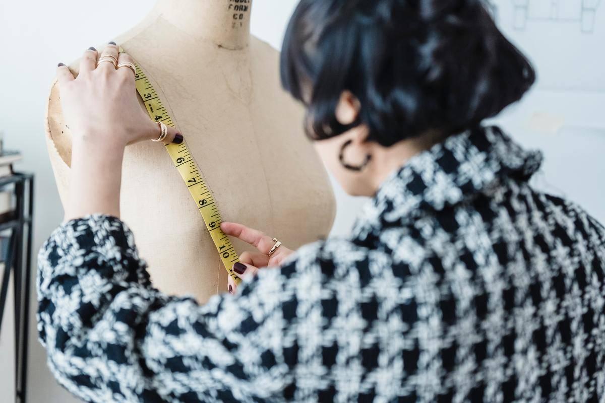 Woman measures mannequin