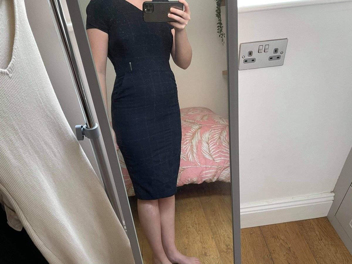 @thegradmedic's dress that she wore for her clinical exams. It's a navy blue short-sleeved dress that goes past her knees