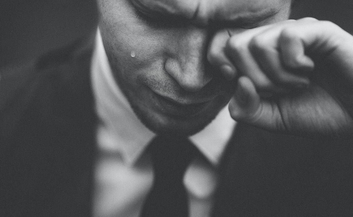 Man in a suit crying