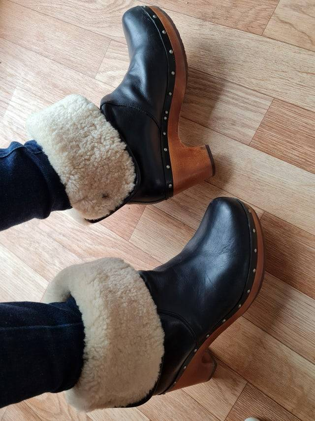 Photo of a woman wearing fluffy UGG boots.
