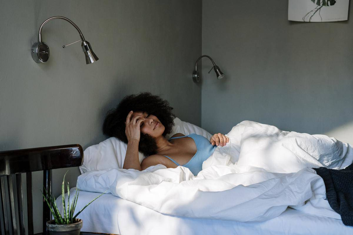 Woman alone in bed